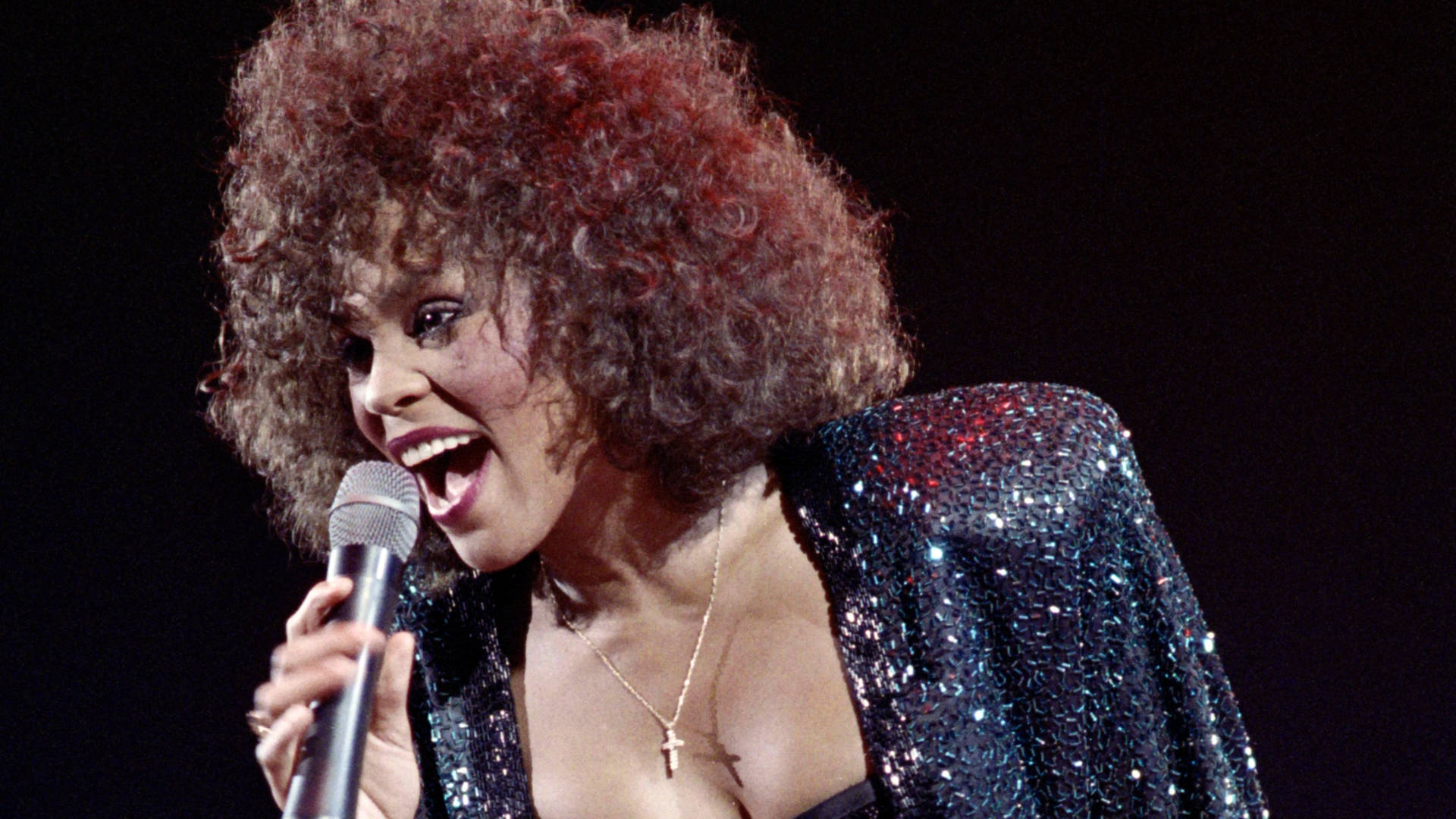 Whitney Houston performs in 1988. The new Showtime documentary, Whitney: Can I Be Me, includes footage of her world tour in 1999. Photo: Bertrand Guay/AFP/Getty Images