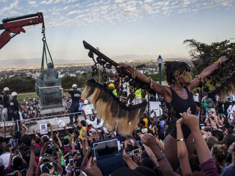 Students cheer as the Cecil Rhodes statue is removed from the University of Cape Town in South Africa in April 2015.