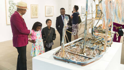 Guests viewing work by Thornton Dial, Jr., 'The Slave Ship,' 1988 in 'Revelations: Art from the African American South' at the de Young.