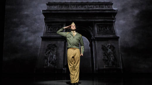 Jerry Mulligan (McGee Maddox) gives a final salute to his old life as a soldier to become an artist in Paris.