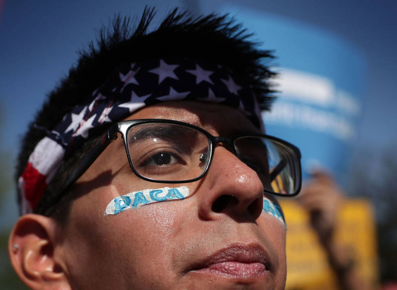 Pro-immigration activist Omar Martinez attends a rally in front of the U.S. Supreme Court April 18, 2016 in Washington, D.C.
