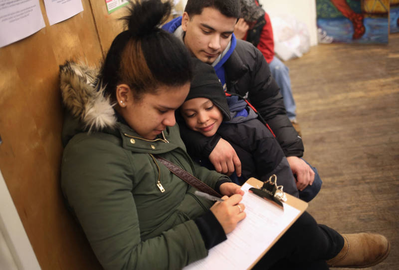 A family fills out an application for Deferred Action for Childhood Arrivals (DACA), at a workshop on February 18, 2015 in New York City.