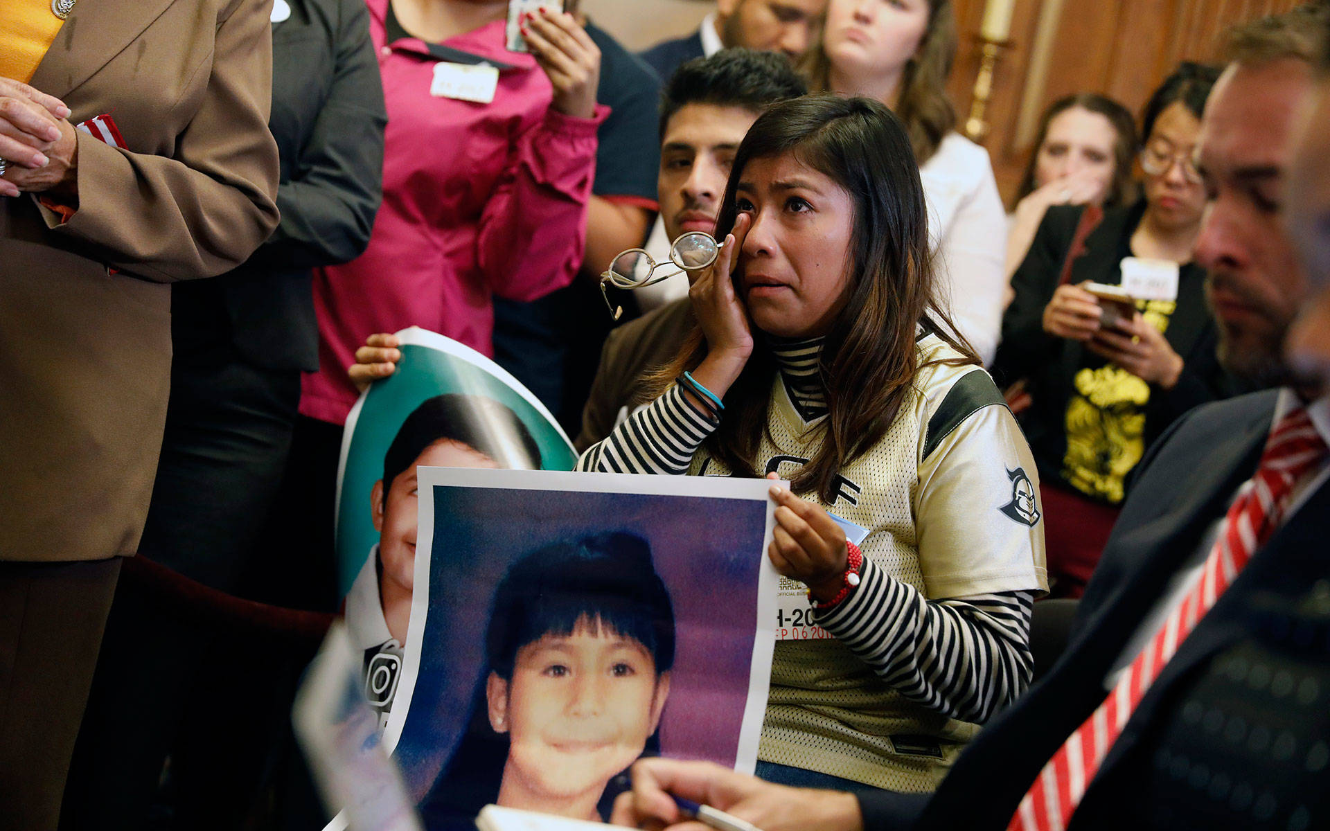 Karen Caudillo cries as she looks on during a news conference about President Donald Trump's decision to end the Deferred Action for Childhood Arrivals (DACA) program at the U.S. Capitol on September 6, 2017 in Washington, D.C.