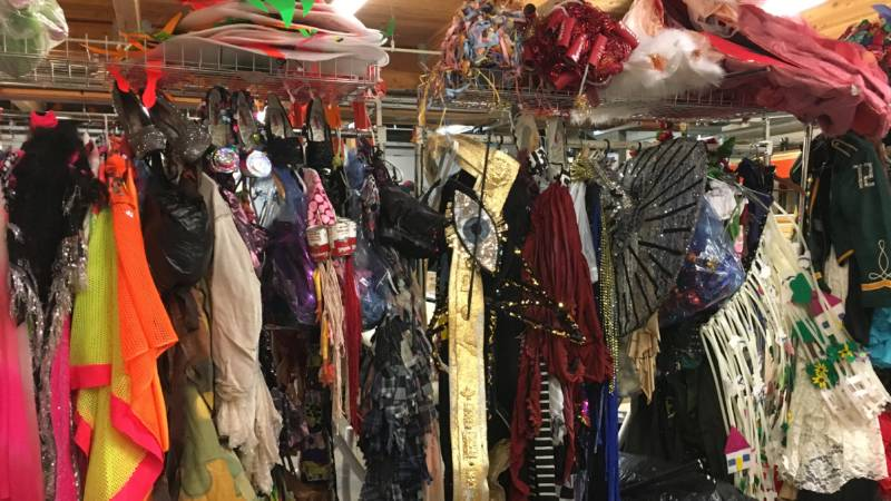Costumes for A 24-Decade History of Popular Music pack the basement of The Curran Theater.