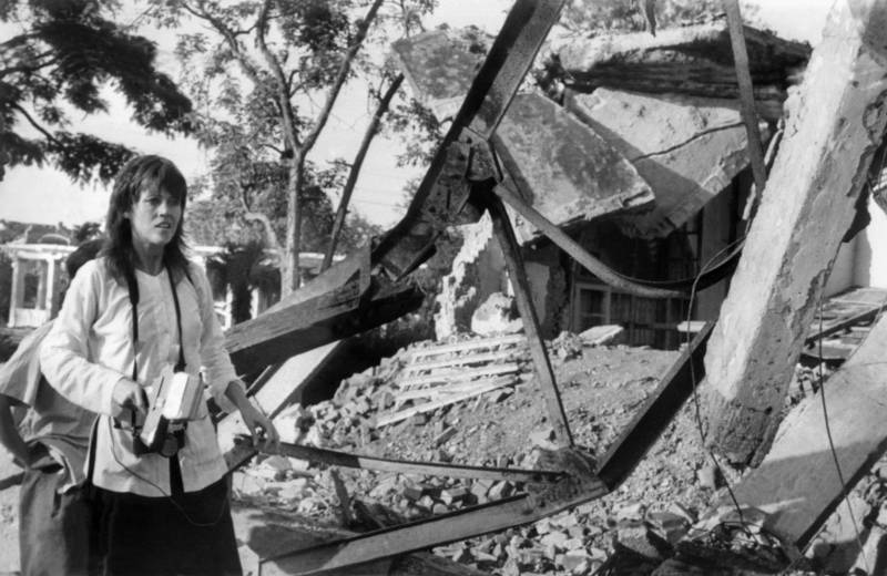 Jane Fonda, holding a camera, visits 25 July 1972 a Hanoi site bombed by US airplanes. Fonda's trip to North Vietnam was part of her protest campaign against the US involvement in the Vietnam war. US bombers, including B-52 strato-fortresses, started to bomb the North Vietnamese capital and its port Haiphong in April 1972.