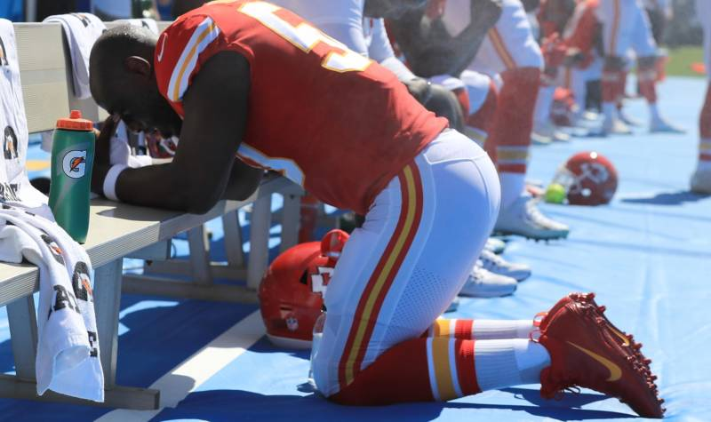Justin Houston of the Kansas City Chiefs takes a knee during the National Anthem before a game against the Los Angeles Chargers, Sept. 24, 2017 in Carson, California.