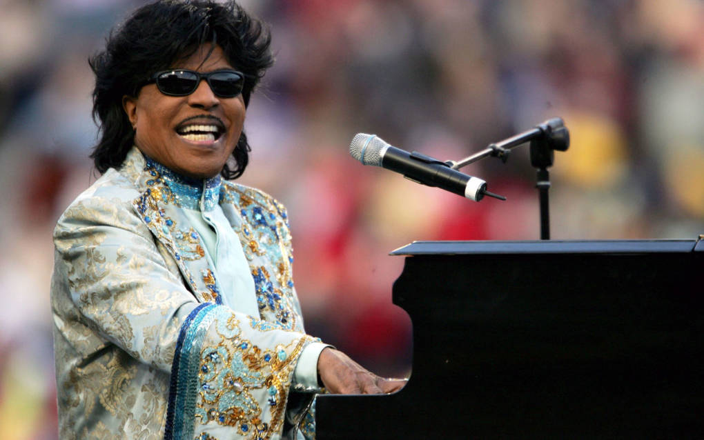 Little Richard performs during a halftime show at the Liberty Bowl in Memphis, Tenn., on Dec. 31, 2004. (via NPR)