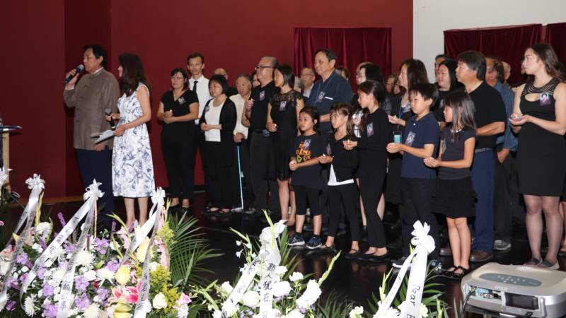 Representatives of Ann Woo's two families, her personal family and that of Chinese Performing Arts of America, spoke and performed at her memorial.