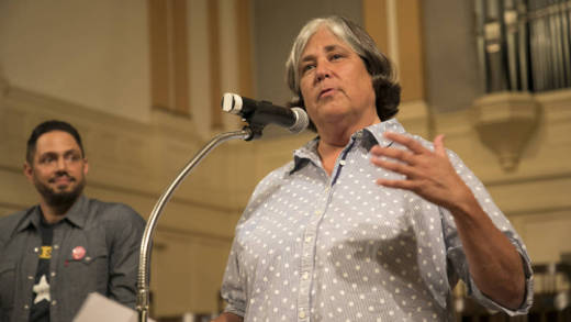 Retired police sergeant Karen Alberts shares personal security tips with the members of the San Francisco Gay Men's Chorus in advance of their tour around the southern United States.