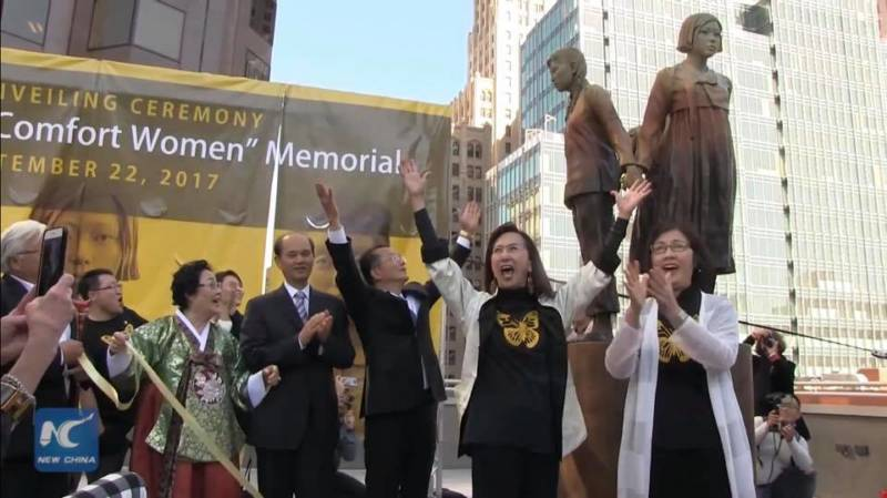 Lillian Sing and Julie Tang celebrate the unveiling of the 'Column of Strength'