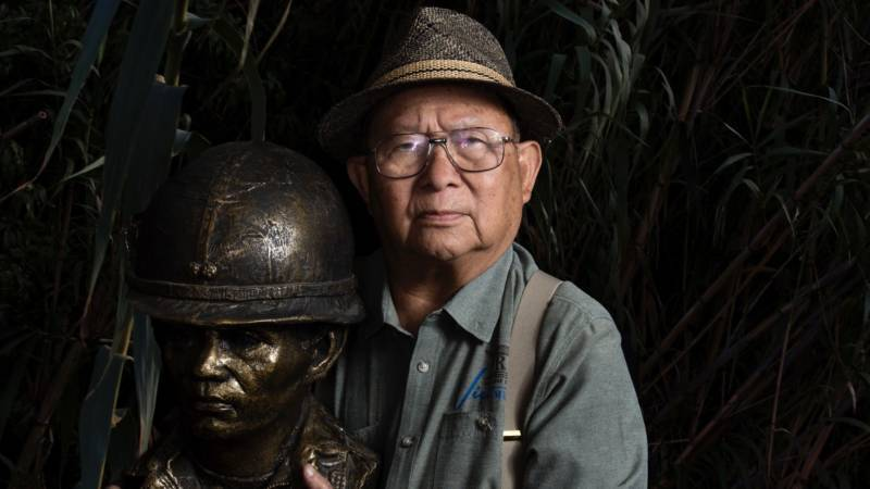 "Loc Vu, an 85-year-old retired colonel who served in the Army of the Republic of Vietnam, holds a bust of a South Vietnamese soldier at the Viet Museum in San Jose. ""This is a beautiful work from the museum,"" he says. ""It reminds me of the unknown soldier."""