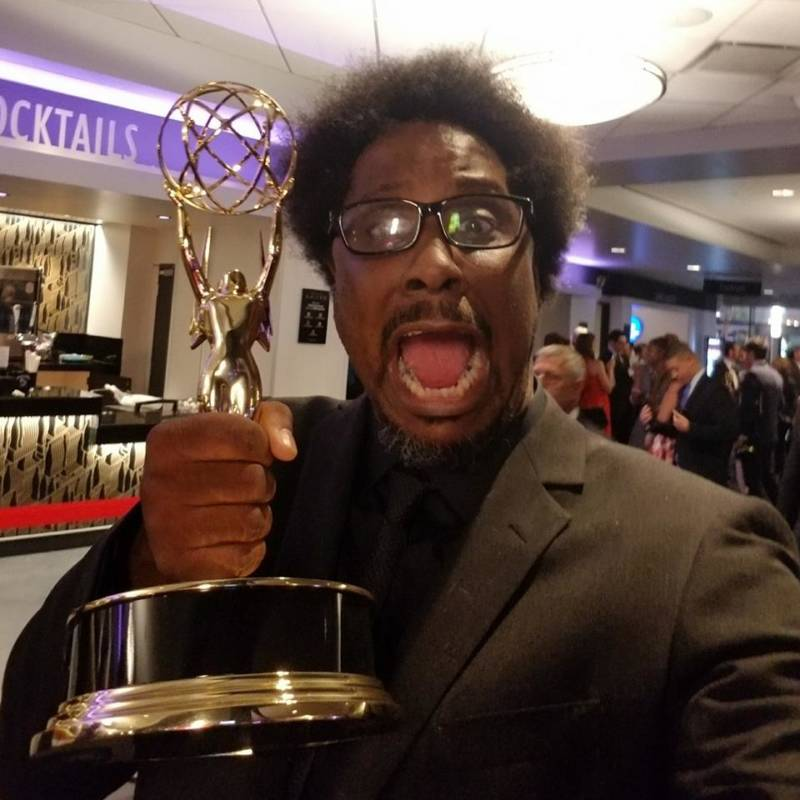 W. Kamau Bell with his Emmy