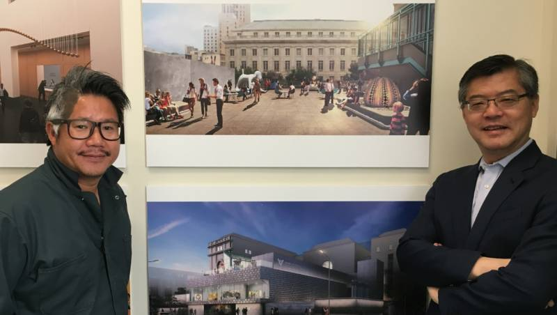 Asian Art Museum executive director Jay Xu and architect Kulapat Yantrasast pose in front of the plans for the museums expansion.