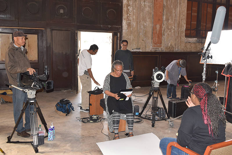 Filmmaker Cheryl Fabio (center) on set at 16th Street Station.