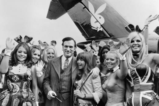 """In this 1970 photo, Hefner, his then girlfriend actress Barbara Benton and other playmates arrive at Le Bourget airport in France with the Playboy jet """"Big Bunny""""."""