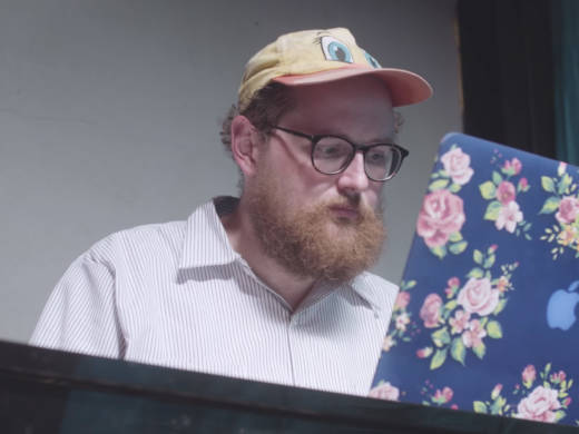 Dan Deacon works at his computer while scoring 'Rat Film'