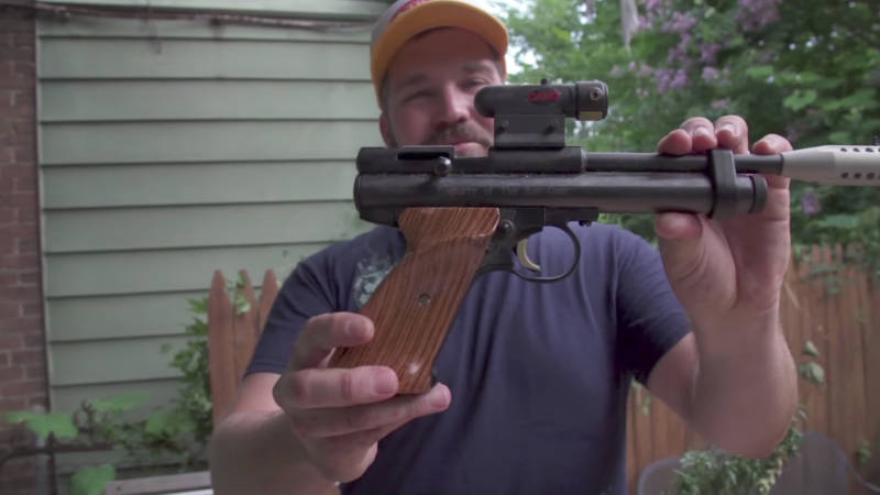 Matt Fouse, also known as the Rat Czar, shows off his collection of weapons that he uses to hunt for rats in his Baltimore backyard.