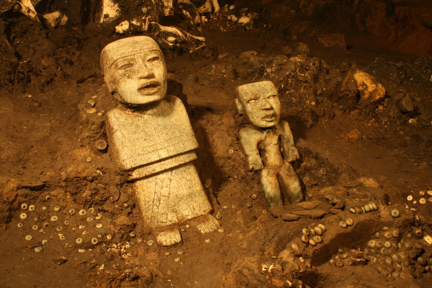 Detail of two standing anthropomorphic sculptures discovered near the terminus of the tunnel beneath the Ciudadela and the Feathered Serpent Pyramid.