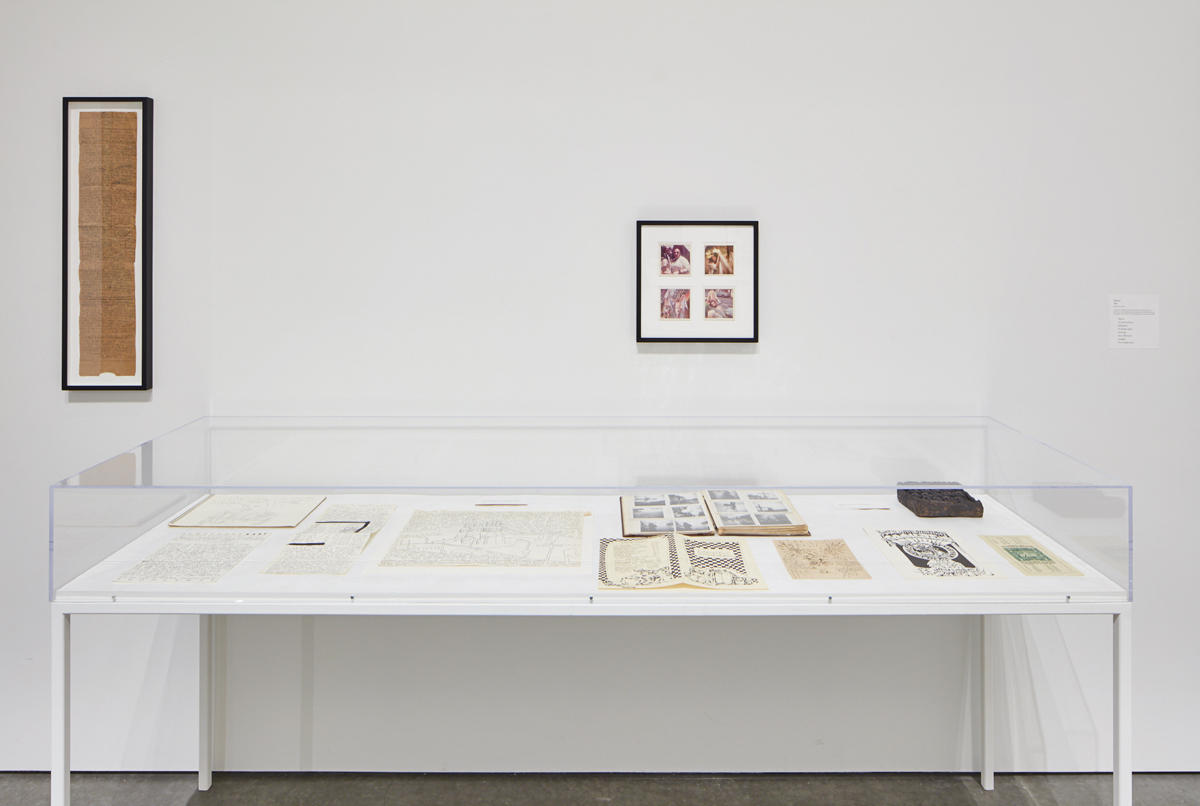 Installation view with vitrine containing 'First letter home.'
