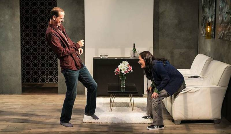 (L to R) Ian (Robert Parsons), the bouquet of flowers, and Cate (Adrienne Walters) negotiate a deadly dance in 'Blasted' by Sarah Kane.