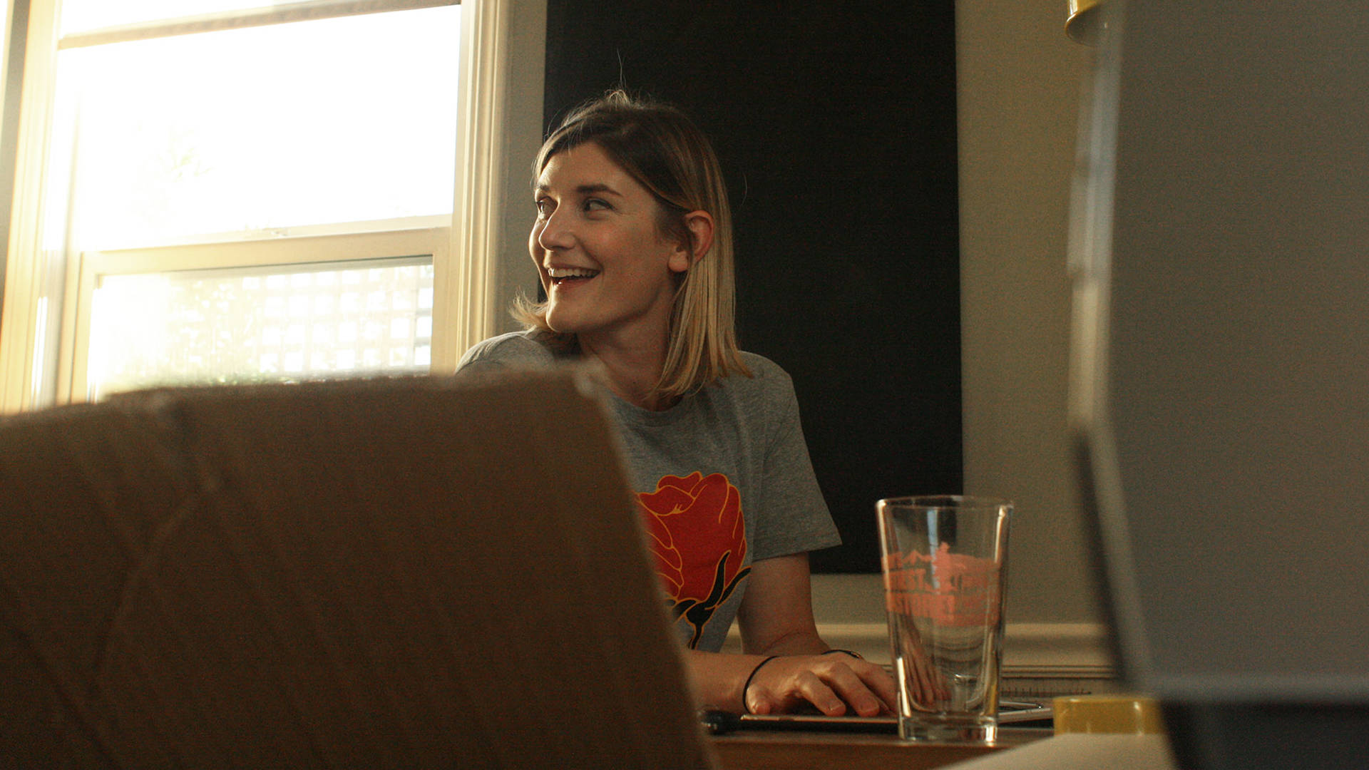 Illustrator Mikayla Butchart wearing one of her 'Rose-ilience' t-shirts in her Santa Rosa home studio. Gabe Meline/KQED