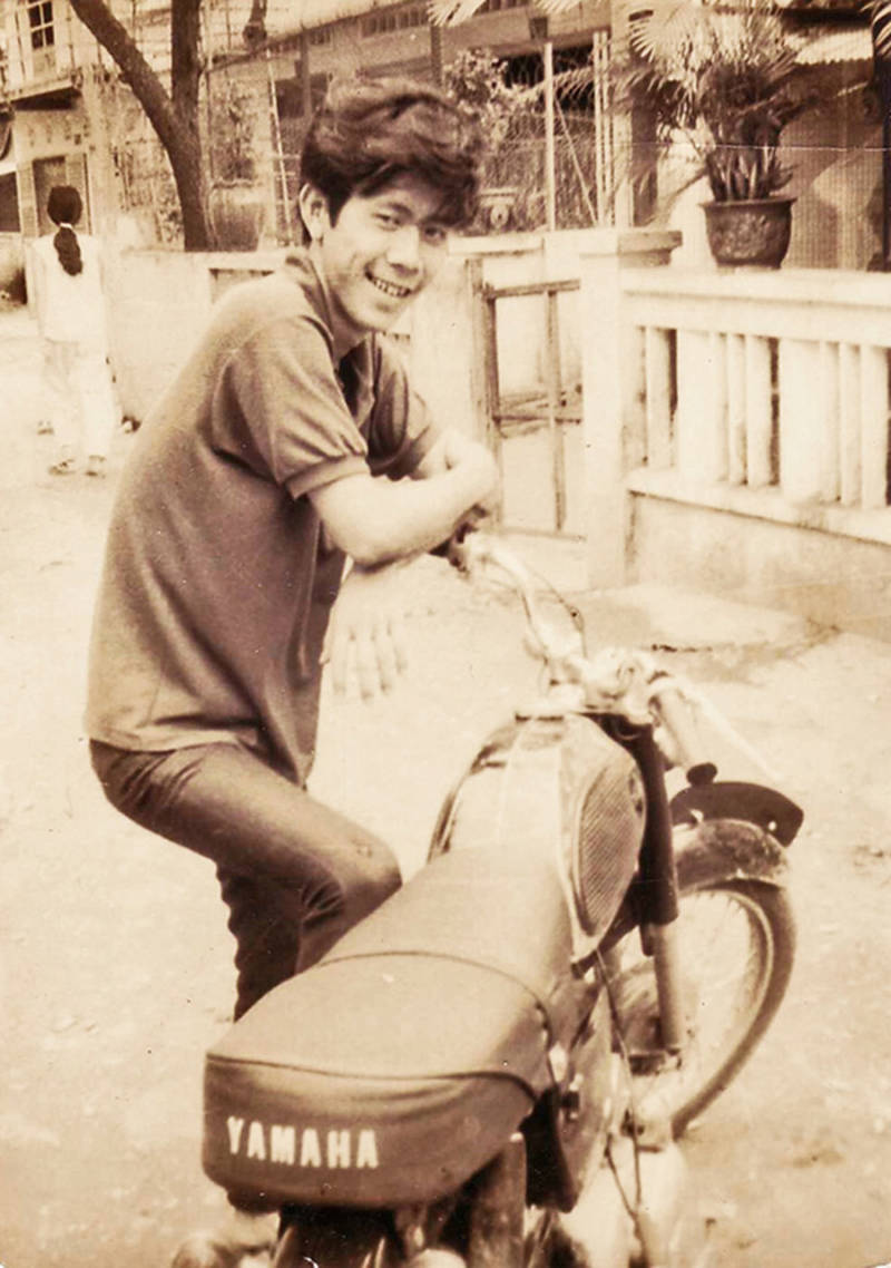 Nguyen's dad with a motorcycle in Vietnam
