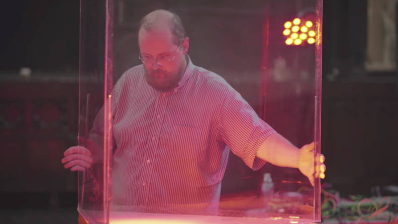 Dan Deacon positions a plexiglass case used to hold rats for the 'Rat Film' score.