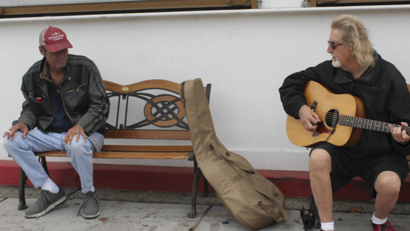 Musician Buzzy Martin entertains a passerby at a Santa Rosa shelter.
