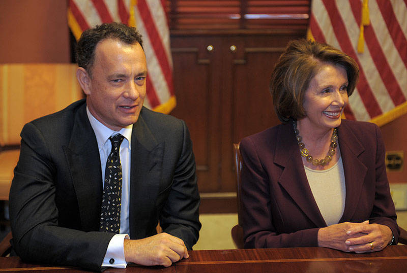 Nancy Pelosi sits with Tom Hanks during a photo-op in her private conference room at the Capitol on March 5, 2008 in Washington, DC.