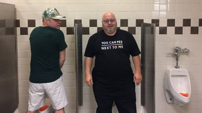 Transgender member of the San Francisco Gay Men's Chorus Tom Kennard poses in the men's bathroom at a rest stop en route from Birmingham, AL to Knoxville, TN. Kennard was one of a group of 250 singers traveling through the south on the choir's 'Lavender Pen Tour'.