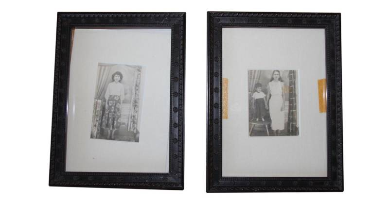 Two framed prints by an unknown Puerto Rican photographer of two anonymous townspeople in Lares, among the few things Norma Quintana saved from the fire.