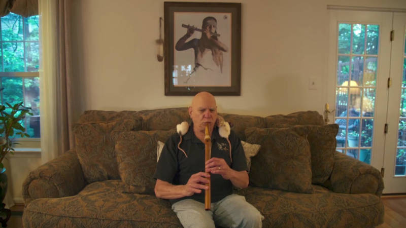 Louis Eagle Warrior, celebrated musician and member of the Lenape Indian Nation, plays the flute in his living room.