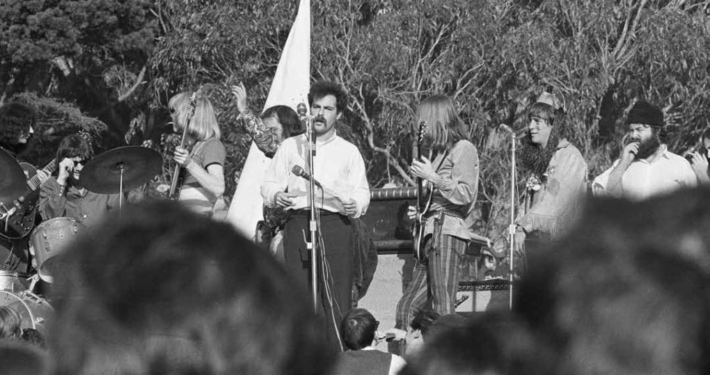 Rubin hopping the stage at  a Grateful Dead concert for the Human Be-In in 1967. Fantagraphics Books
