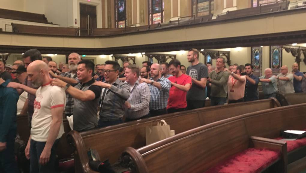 Members of the San Francisco Gay Men's Chorus give each other a group back-rub at the start of a rehearsal leading up to their tour of several southern states.