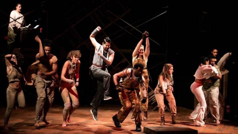The Animals sing and stomp for the revolution in 'The Farm' by Jon Tracy.
