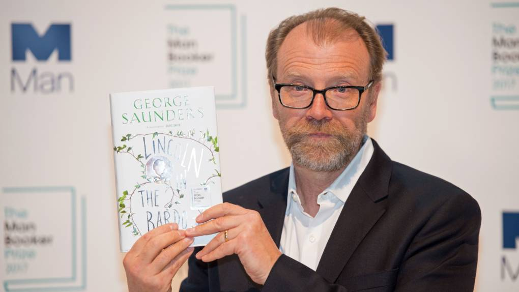 Author George Saunders poses with his book Lincoln in the Bardo at the Royal Festival Hall in London on Monday. On Tuesday, he was announced as the winner of the 2017 Man Booker Prize for Fiction.