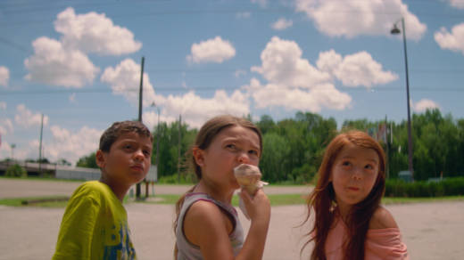 Six-year-old Moonee (Brooklynn Prince, center) and her buddies Scooty (Christopher Rivera, left) and Jancey (Valeria Cotto) run wild around her motel home in 'The Florida Project.'