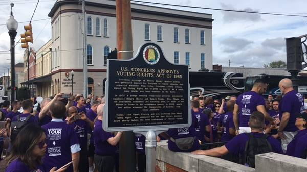 Singers from the San Francisco Gay men's Chorus and Oakland Interfaith Gospel Choir pour onto Edmund Pettus Bridge in Selma, Alabama, on the second day of their tour around five southern states.