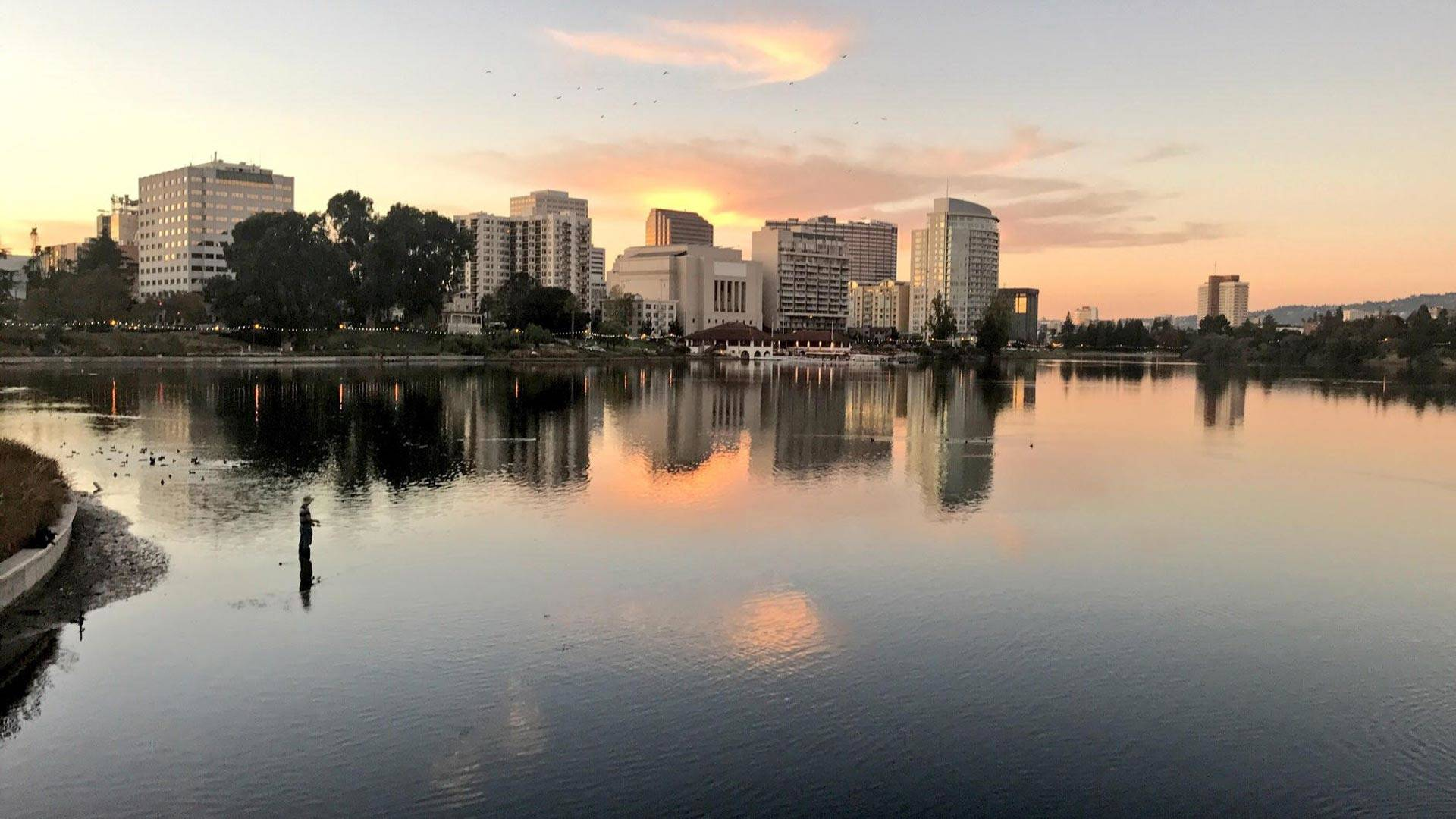 A fisherman casts his line in Lake Merritt.  Pendarvis Harshaw