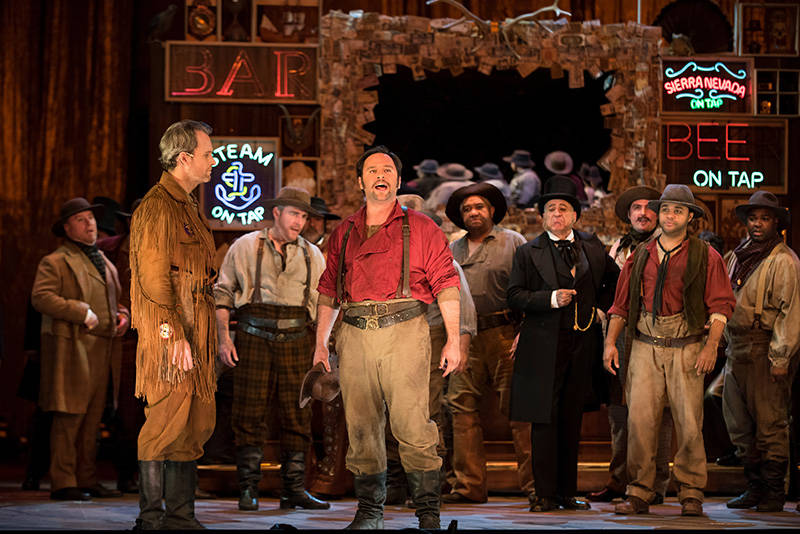 Ryan McKinny as Clarence and Paul Appleby as Joe Cannon with the San Francisco Opera Chorus in John Adams' 'Girls of the Golden West.'