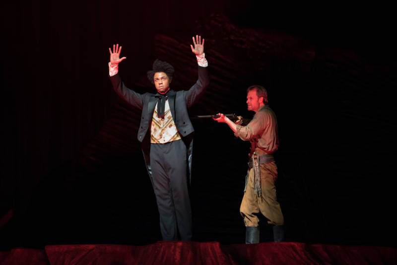 Davone Tines and Ryan McKinny in a scene of racial abuse in 'Girls of the Golden West'