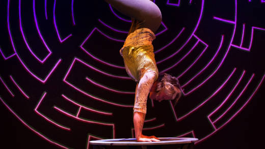 Eka.Boo.Button performs a very long handstand in 'Circus Veritas' by Kinetic Arts production.