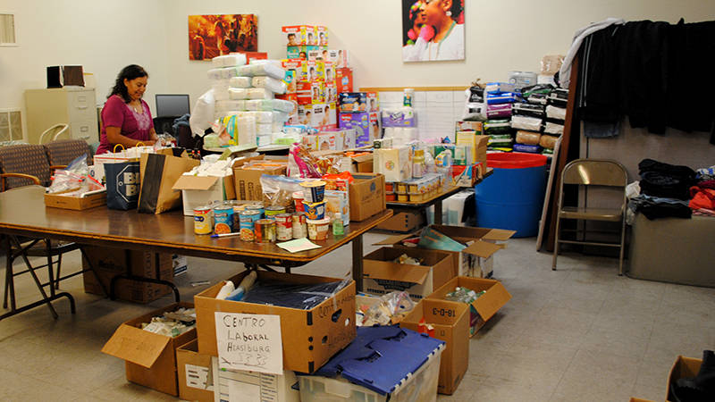 A volunteer organizes supplies for fire evacuees at radio station KBBF's donation center in Santa Rosa in 2017.