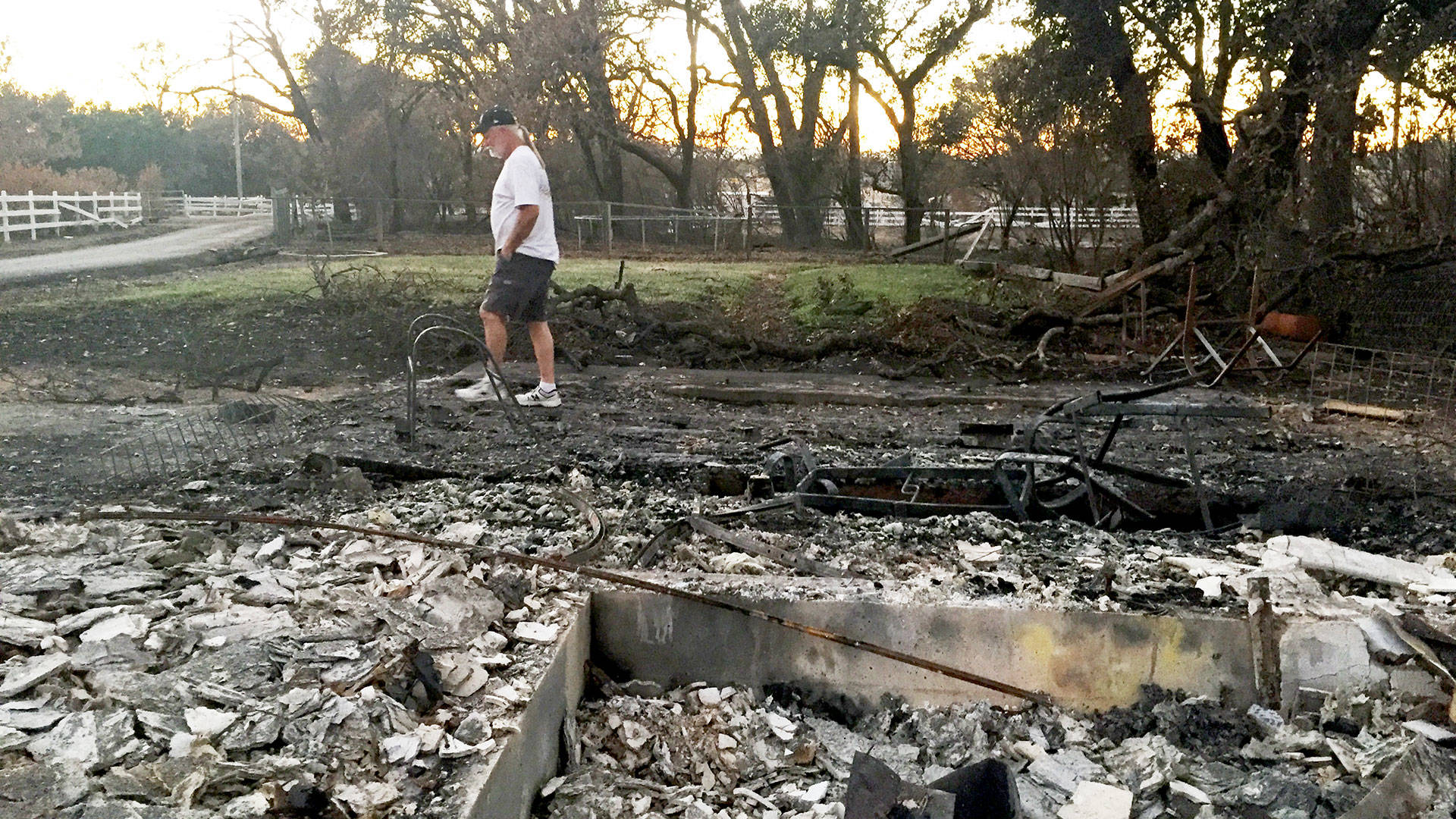 The author's dad walks among the ruins at his childhood home in Larkfield.