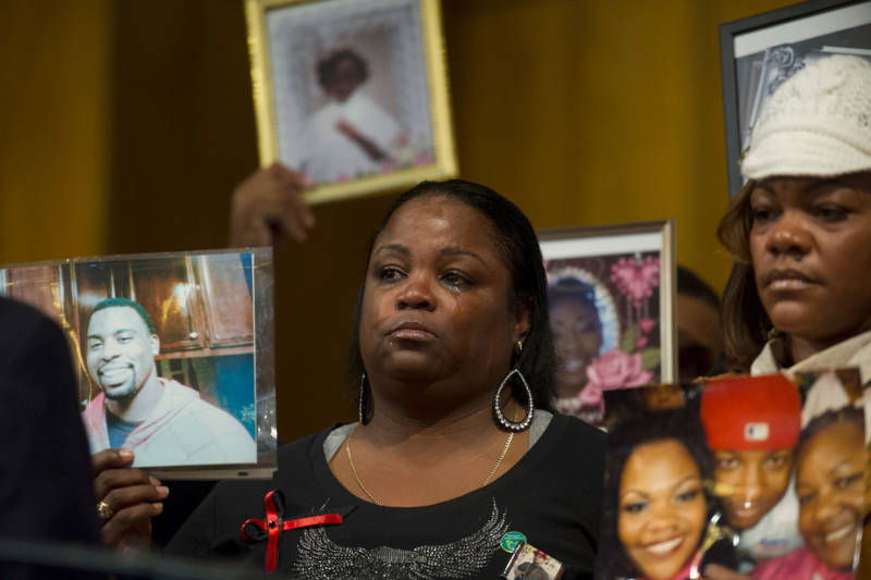 Antionette Johnson holds a photo of her son Terrell Reams, 23, who was shot and killed in Oakland in 2013.