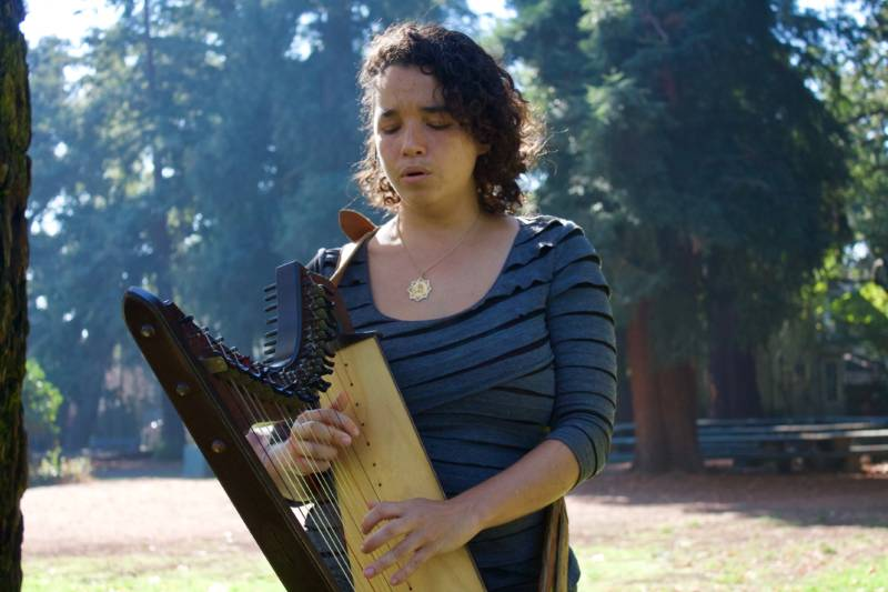 María José Montijo plays her harp at Dimond Park in Oakland.