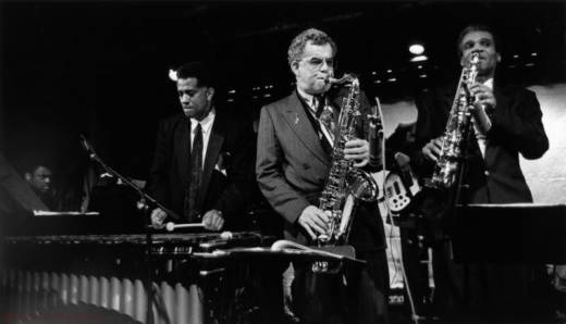 Mel Martin playing tenor sax between Bobby Hutcherson (left) and Bobby Watson (right). In the back left corner is Mulgrew Miller on piano