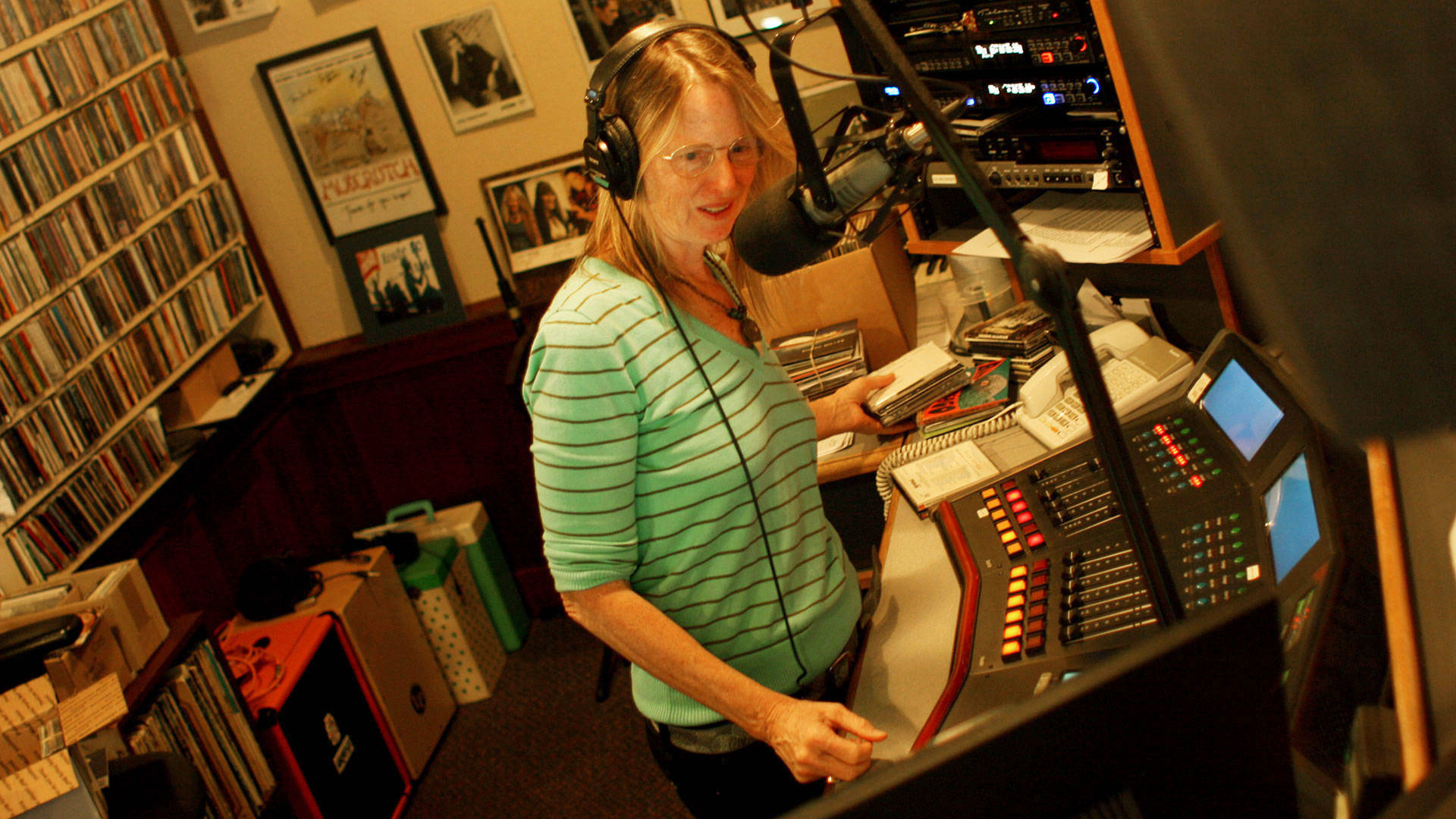 Robin Pressman on the air at KRSH-FM in Santa Rosa. Pressman lost her house in the Oct. 8 fires, and finds weekly healing in music for listeners. Gabe Meline/KQED