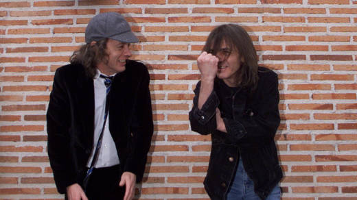 Angus (L) and Malcolm Young of the hard rock group ACDC inaugurate 22 March 2000 the first street in the world bearing their group's name in Leganes, 29 kms from Madrid. Angus (L) and Malcolm Young of the hard rock group ACDC inaugurate 22 March 2000 the first street in the world bearing their group's name in Leganes, 29 kms from Madrid.