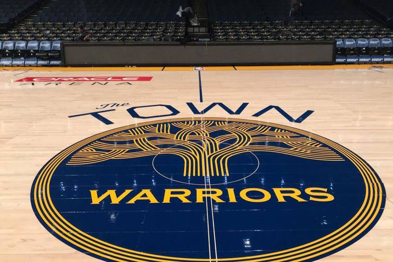 The Warriors' 'Town' logo at center court.